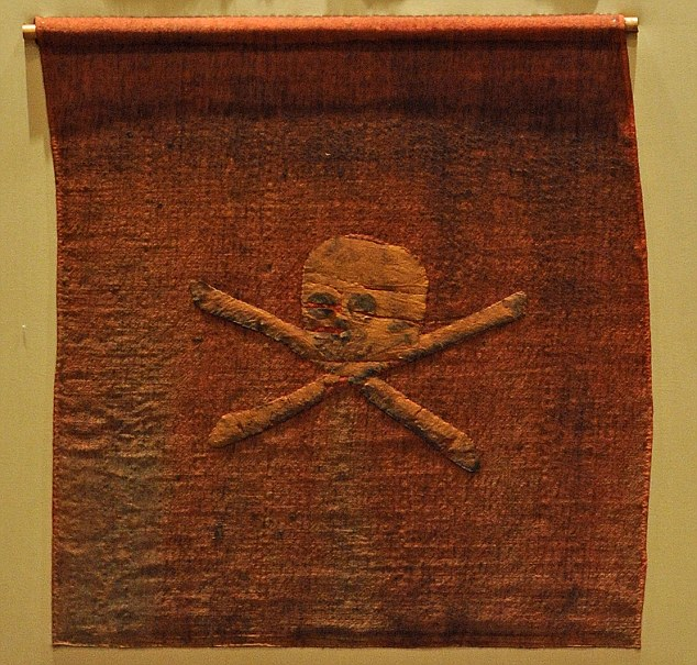 Solent: ORIGINAL JOLLY ROGER PIRATE FLAG REVEALED. A rare 18th Century red Jolly Roger pirate flag has been uncovered and gone on display for the first time. The flag was captured in battle off the North African coast in 1780. The flag is now on show at the National Museum of the Royal Navy (NMRN) at Portsmouth Historic Dockyard, Hants. SEE OUR COPY FOR THE FULL STORY. Pictured: Curator of Artifacts Richard Noyce with the original Jolly Roger Pirate Flag. Plus close-ups of the flag © The News, Portsmouth/Solent UK +44 (0) 2380 458800